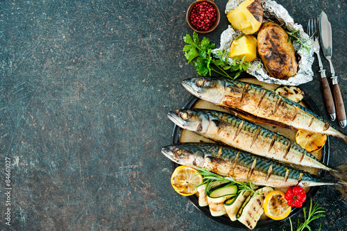 Aluminium Prints Grill / Barbecue Grilled mackerel fish with baked potatoes