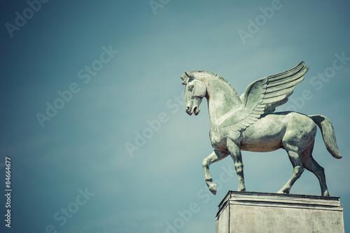 Fototapeta statue of pegasus on the roof of opera in poznan poland