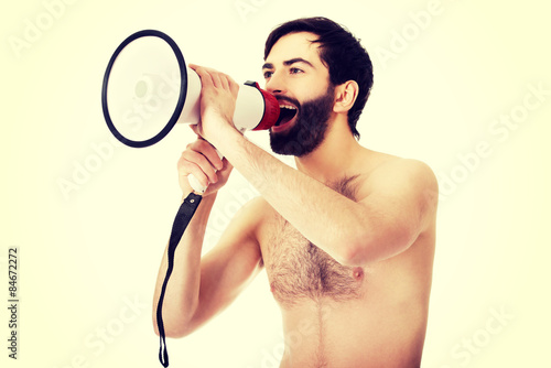 Fototapety, obrazy: Shirtless man shouting using a megaphone.
