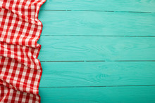 Plaid Tablecloth On Blue Wooden Background