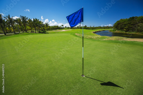 Poster Golf Golf course. Beautiful landscape of a golf court with palm trees