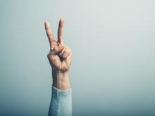 Male Hand Displayin Victory Sign