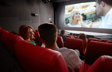 Happy Couple Watching Movie An...