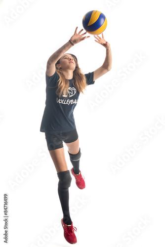 Foto  Mädchen wehrt EINEN Volleyball ab