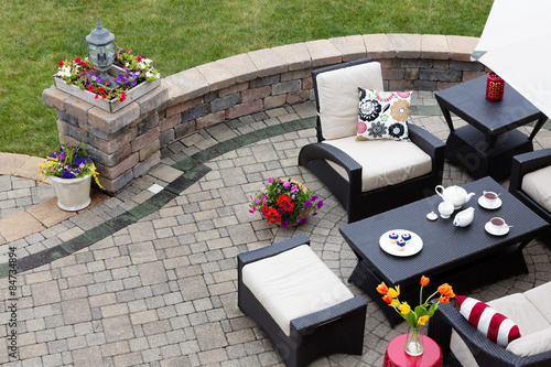Papel de parede Brick paved patio with patio furniture