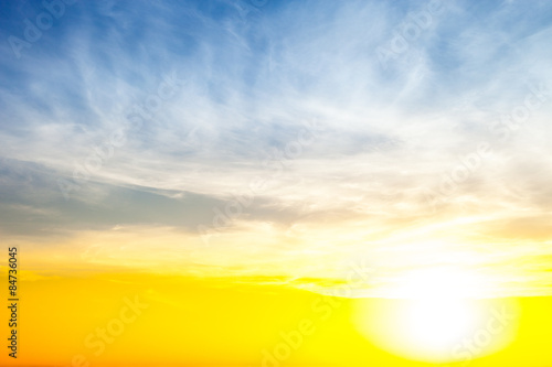 Poster Jaune Beautiful blue and yellow sky with sunrise.