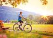 Leinwandbild Motiv woman enjoying nature with bike/e-power 06