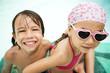 Happy little friends having fun in swimming pool