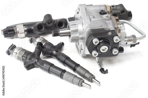 Fotografía  Two new solenoid injectors for diesel fuel lying on a white background with a ro