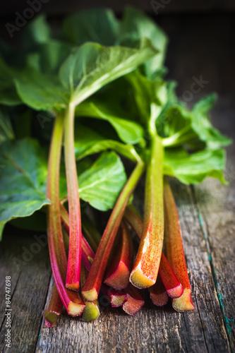 Fotografie, Obraz  fresh organic rhubarb on wooden background