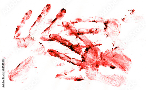 Photo  Bloody handprints on white paper
