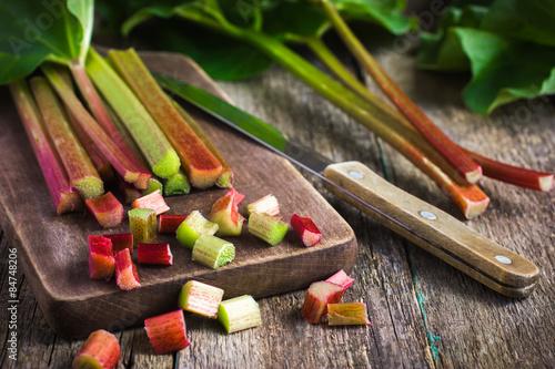 Obraz na plátně  fresh organic rhubarb on wooden background