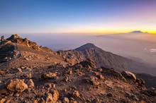 Sunrise On Mount Meru With Mt Kilimanjaro In The Distance, Near Arusha In Tanzania. Africa.
