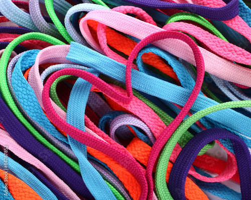 Fotografía  Colorful shoe laces and heart shaped pink shoelace
