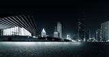 Fototapeta Miasto - Empty asphalt road and modern skyline at night