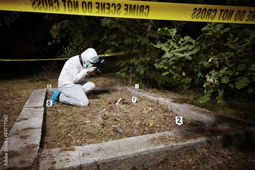 Police photographer on crime scene place