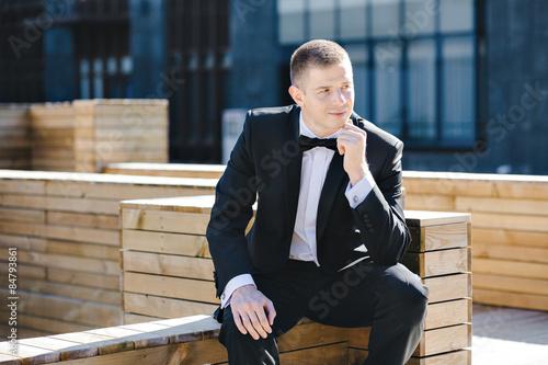 Maxim photo session model in tuxedo outdoors Fototapeta
