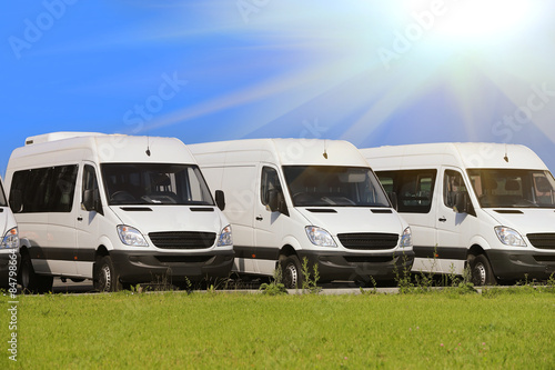 Deurstickers Oude auto s minibuses and vans outside