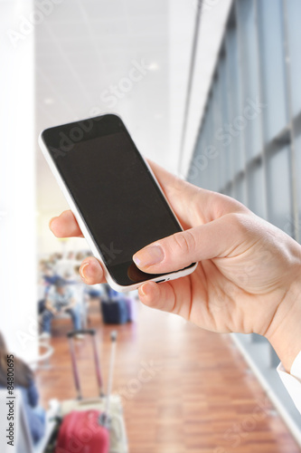 Fotografie, Obraz  hand using Smartphone in the airport