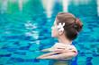 portrait of beautiful woman in luxury pool
