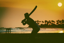 Boy Playing Cricket At Sunset ...