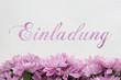 Einladung - Schrift und Blumen