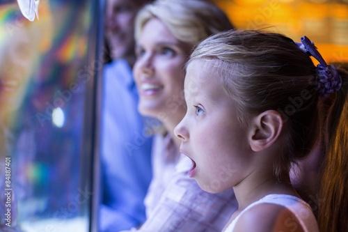 Surprised daughter behind a starfish tank