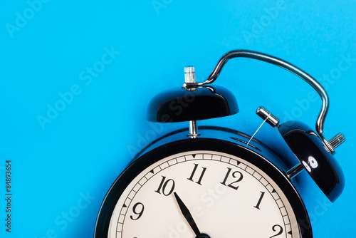 Fotografie, Obraz  Old vintage alarm clock standing on the blue surface