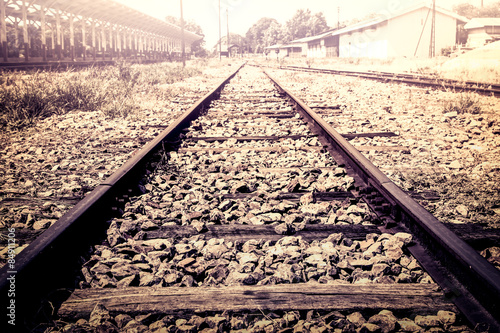 railway track in train station in vintage color filter