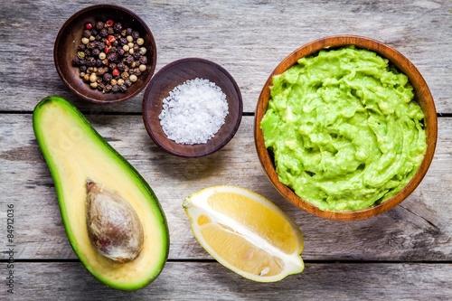 Fotografie, Obraz  ingredients for homemade guacamole: avocado, lemon, salt and pepper