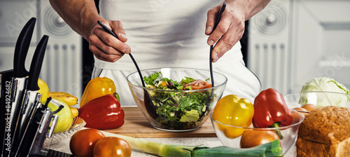 Photo sur Aluminium Cuisine man cutting vegetables