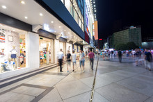Modern Shopping Street And Peo...