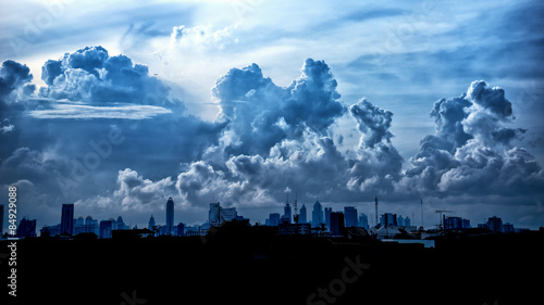 Fotobehang Hemel Dark blue storm clouds over city in rainy season