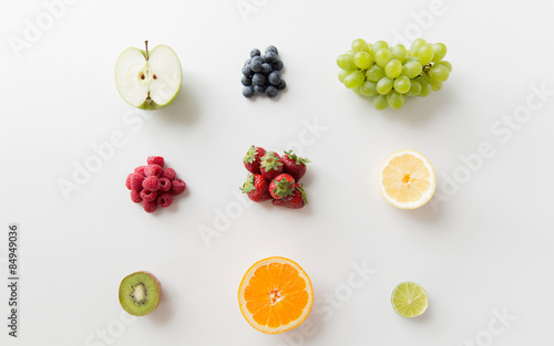 Poster Cuisine ripe fruits and berries on white surface