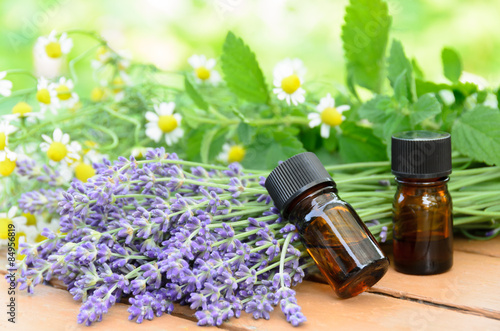 Photo  essential oils with lavender and herbs