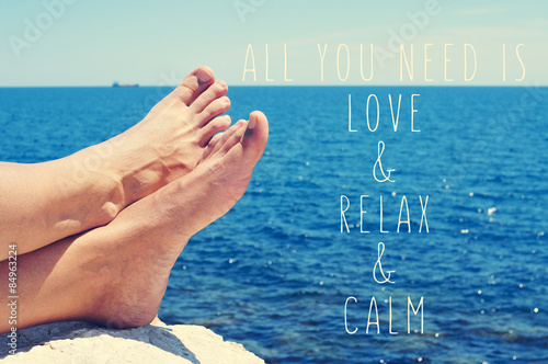 Photo  young man relaxing on the sea and text all you need is love and
