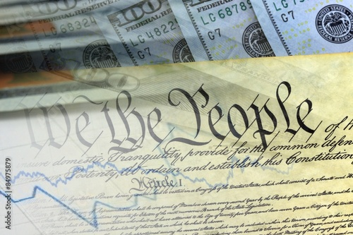 Photo  US Constitution with One Hundred Dollar Bills sitting above it - The American Re