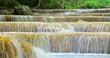 Cascades of silky waterfalls with fresh smooth milky water falling