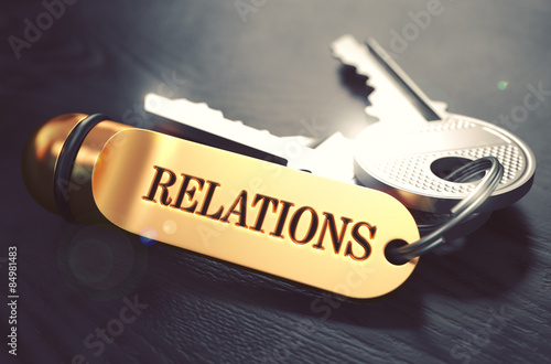 Foto  Relations - Bunch of Keys with Text on Golden Keychain.