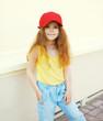 Fashion kid concept - portrait of stylish little cute girl child