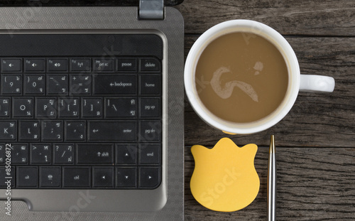 Foto op Plexiglas Chocolade work office desk with a cup of coffee computer laptop, notebook,
