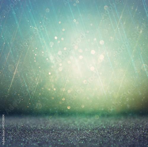 Photo  glitter vintage lights background. gold, silver, blue and black