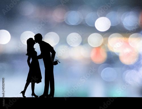 Fotografia  Pary całowanie w neonowym tle.