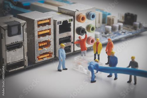 Fotografie, Obraz  Miniature Network Engineers At Work