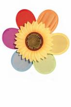 Close-up Of Rainbow Fabric Pinwheel With Plastic Sunflower Isola