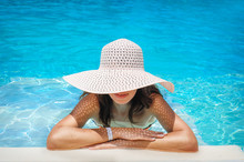 Young Woman In White Hat Resti...