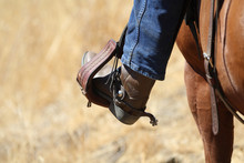 A Close Up View Of A Cowboy Wi...
