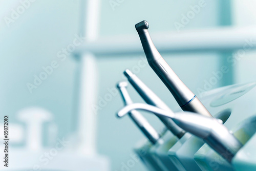 Fotografering  Different dental instruments and tools in a dentists office