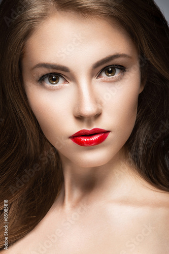 Beautiful woman with evening make-up, red lips and curls Poster