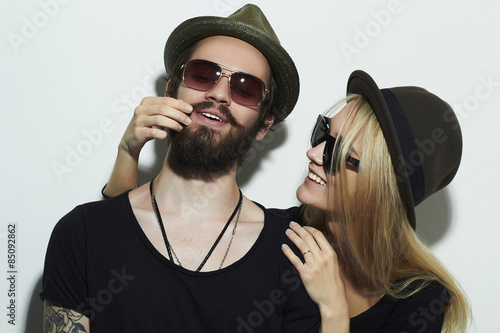 Fotografie, Obraz  fashion beautiful happy couple in hat.Hipster boy and girl